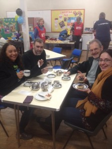 Joe Human MBE and Fairtrade VIP's enjoying a cup of coffee.